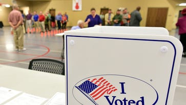 Dozens of voters await their turn to cast their ballot in the 2016 Election Tuesday morning at Brandon Baptist Church voting precinct.