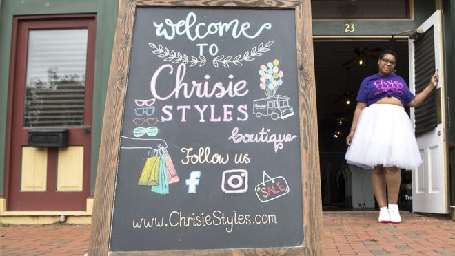 Christine Hooper, owner of Chrisie Styles Boutique, stands in front of her recently opened Burlington City clothing shop.