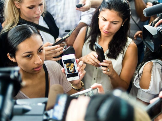 Julissa Leal displays a cellphone image of her missing brother, Frank Hernandez, as she speaks with the media outside a family reunification center set up at the Beardall Senior Center, Monday, June 13, 2016, in Orlando, Fla., for family members of the victims of the Orlando nightclub shooting. (Zack Wittman/The Tampa Bay Times via AP)  TAMPA OUT; CITRUS COUNTY OUT; PORT CHARLOTTE OUT; BROOKSVILLE HERNANDO TODAY OUT; MANDATORY CREDIT
