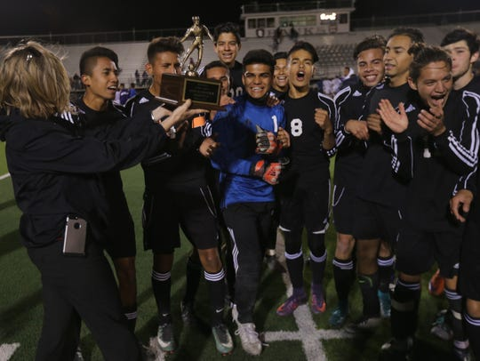 El Paso High players received their bi-district trophy