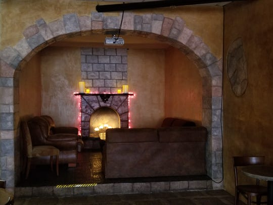 This cozy lounge corner, outfitted with brown couches,