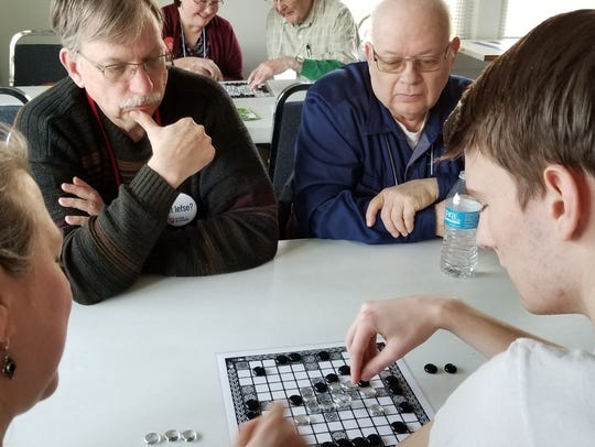 Hnefatafl being played at a recent Nordkap Lodge meeting.