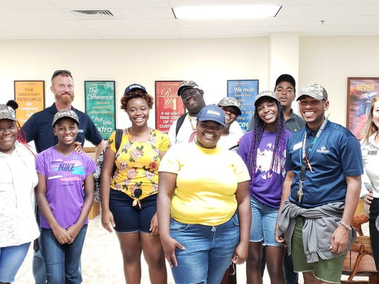 Boys & Girls Clubs Members for Infinity and Garden Terrace Clubhouses appreciated the time St. Lucie Battery & Tire's Jeff Deans and Lindsey Concannon spent teaching them about possible careers.