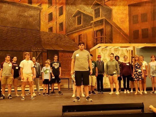 "The evening cast of the Summer Youth Musical Theater Workshop rehearses a scene from ""Sweeney Todd."""