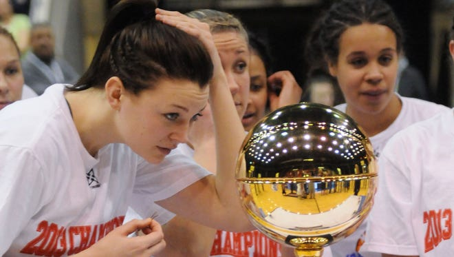 Marist College's Elizabeth Beynnon looks at the trophy after winning the MAAC women's basketball championship game against Iona College Monday, March 11, 2013, in Springfield, Massachusetts.