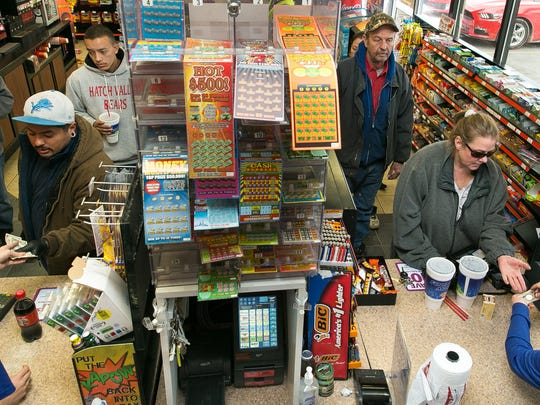 Lines begin to form Friday at Murphy Express on S. Valley Drive as many customers look to purchase Powerball tickets.