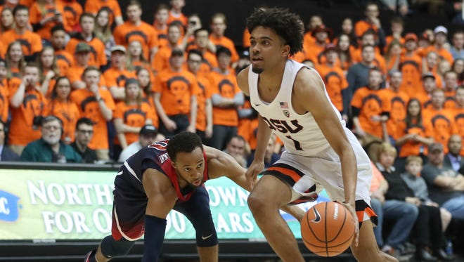 Oregon State Beavers guard Stephen Thompson Jr. (1) dribbles past Arizona Wildcats guard Parker Jackson-Cartwright (0) in the first half  at Gill Coliseum.
