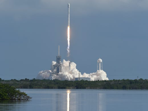 A SpaceX Falcon 9 rocket takes off Pad 39A Kennedy