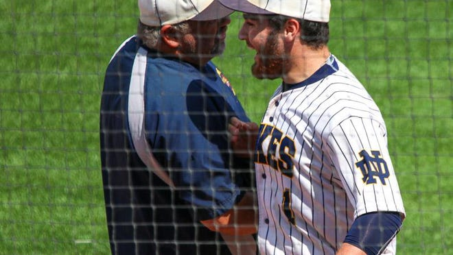 Notre Dame High School third baseman Drew Chiprez (right) talks with assistant coach Daren Orth during the Nikes' state quarterfinal game against Remsen-St. Mary's. Chiprez was named to the Class 1A first team all-state team by the Iowa High School Baseball Coaches Association.