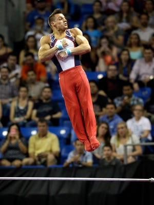 Sam Mikulak competes on the high bar Saturday in St. Louis.