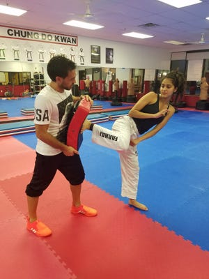 Master Alexander Covert (left) trains Lubna Farhat during a recent session at Olympia Tae Kwon Do in Canton. Covert coaches the upstart P-CEP United team, of which Farhat is a member.