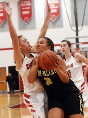 Kendyl Howe draws contact from Sheridan's Emma Conrad during the second half of Tri-Valley's 57-55 loss on Saturday at Glen Hursey Gymnasium.