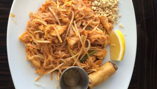Pad Thai is a dish of thin rice noodles, fried egg, tofu, bean sprouts, onion and ground peanuts.