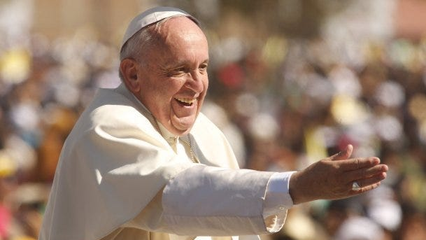 Pope Francis waves to pilgrims at the Municipal Sports Center in San Cristobal de las Casas, Mexico, where he conducts a Holy Mass with the indigenous community of Chiapas on Monday, Feb. 15, 2016.