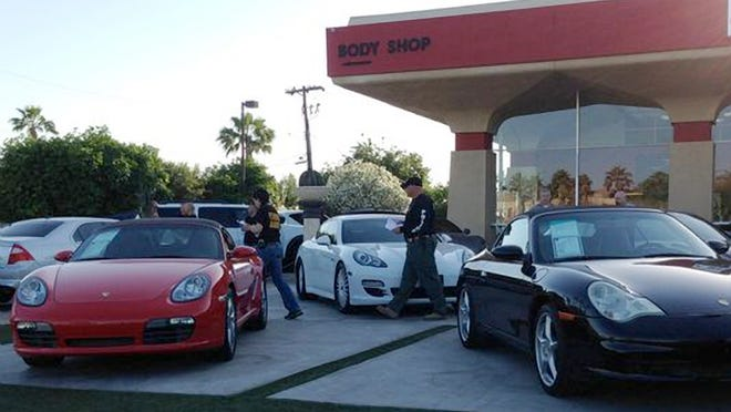 Federal authorities say owners of a luxury car dealership in Scottsdale took bags of cash from undercover agents posing as drug dealers and agreed to launder money through unreported vehicle sales. Brothers Hamid and Saeid Salari of Luxor Auto Group were arrested Wednesday on money laundering, conspiracy and currency-violation charges. A third man, Farah Isaac, who owns a jewelry store and works with the Salaris, was arrested on similar charges.