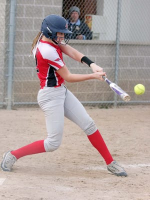Sheboygan South's Ashley Weimann (12) hits the ball against Sheboygan North Tuesday April 25, 2017 in Sheboygan, Wis.