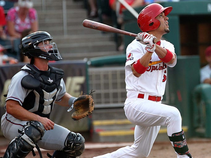 Rafael Ortega the Springfield Cardinals hits a deep fly ball against the NW Arkansas Naturals at Hammons Field on July 20, 2014.
