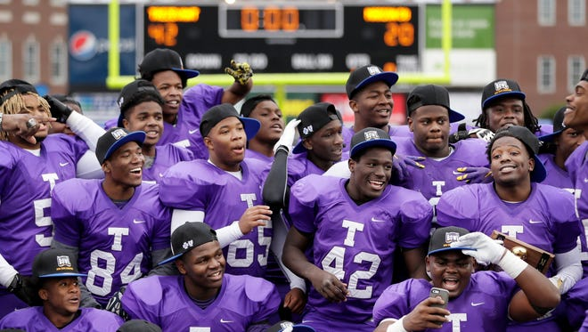 Trezevant players celebrate after defeating Marion County 42-20 to win the Division I Class 2A Tennessee high school football championship game Saturday, Dec. 3, 2016, in Cookeville, Tenn.