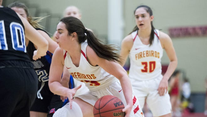 Chaparral junior Maddie Vick (13) drives to the basket as Arcadia junior Dylan Watkiss (10) defends in the first half at Chaparral High School in Scottsdale on Friday, Jan. 13, 2017.