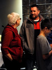 Corey Schoonover, right, talks to people Tuesday night, Nov. 7, 2017, at Ale House 1890 in Lancaster. Schoonover, a Republican, led the field of City Council at-large candidates with 3503 votes. Schoonover's fellow Republican John Baus and Democrat Jerry Woodgeard won the other two at-large seats on council.