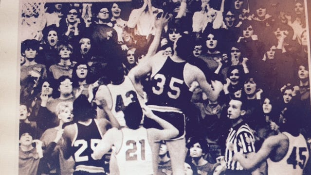 Bill May, shown officiating a game between Marion and Kokomo in 1968, will attend the high school basketball state finals for the 68th consecutive year on Saturday.