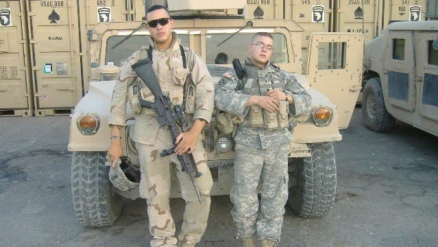 Chris Melendez, left, and a friend while they were stationed in Iraq with his unit that was attached to the 101st Airborne Division in June 2006.