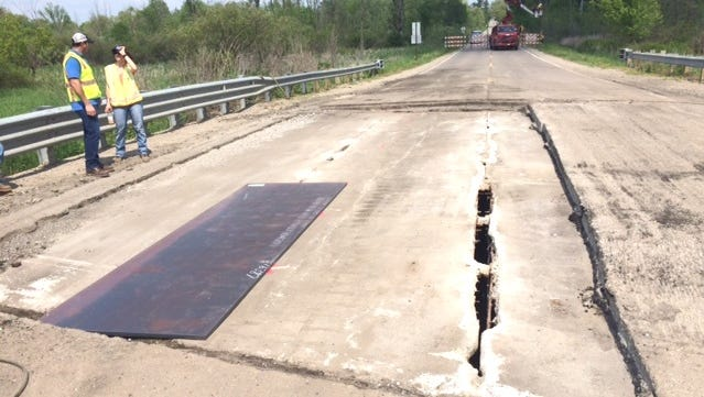 """Emergency repairs of a bridge over the Shiawassee River on Mason Road in May 2016 reopened in the road after an emergency closure. However, further deterioration occurred and the bridge is in """"serious or critical"""" condition as of March 2019, according to Federal Highway Administration standards."""