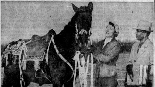 Emily and Albert Omer are shown with the saddle that took quite a detour in its delivery to the Omers.