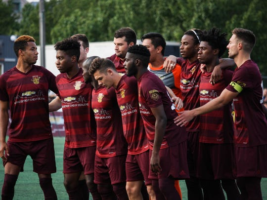 The Detroit City FC starting lineup assembles on the field before the NPSL semifinal match against Midland-Odessa FC on Saturday in Hamtramck.