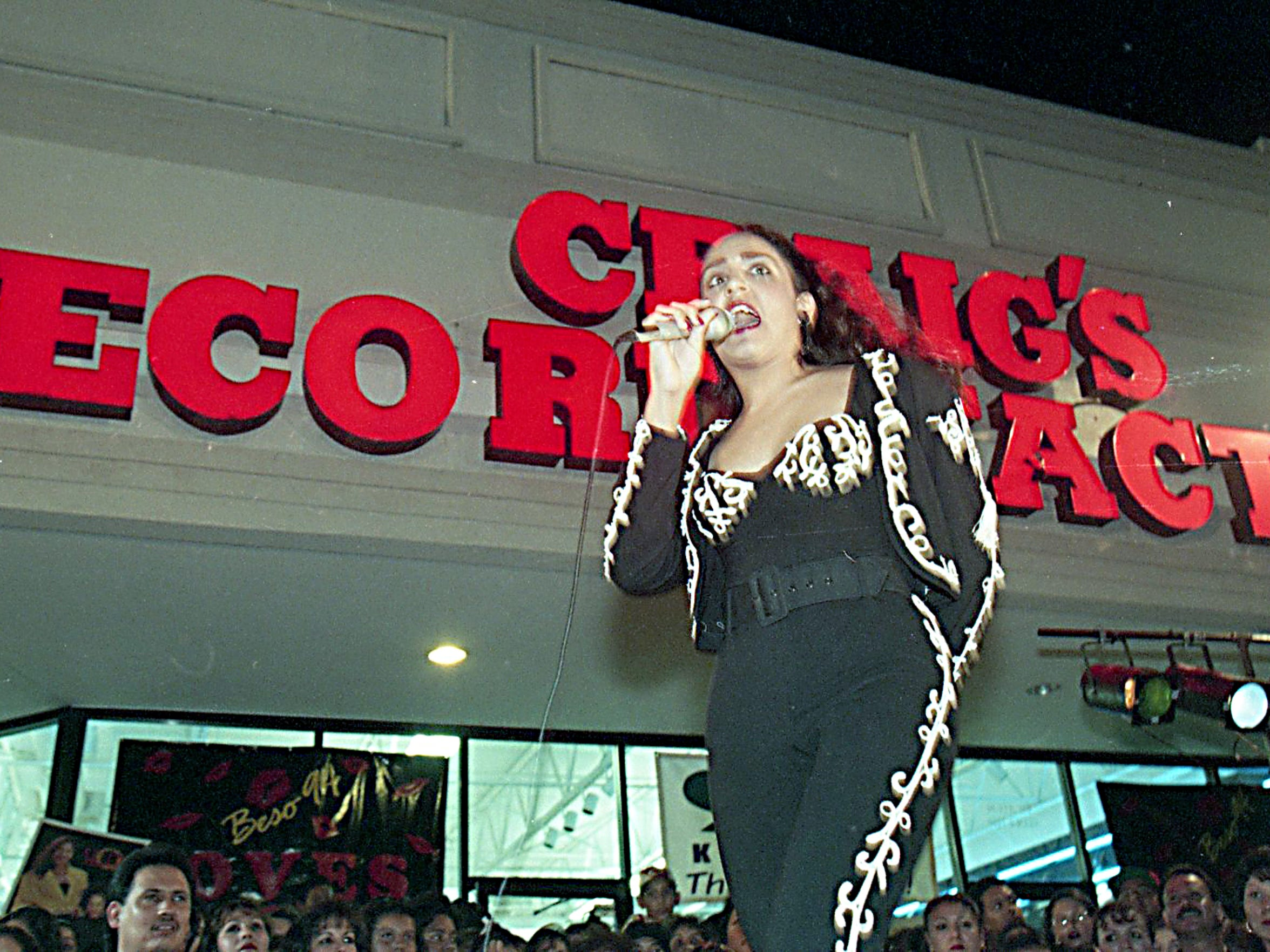 """Marisa Herrera, 12, of Corpus Christi lip-syncs to Selena's 'Bidi Bidi Bom Bom' Monday night, July 17, 1995, outside Craig's Record Factory in Moore Plaza at the release party for """"Dreaming of You."""""""