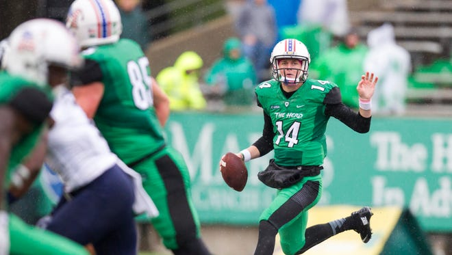 Marshall Thundering Herd quarterback Chase Litton scrambles out of the pocket during the second quarter against the Old Dominion Monarchs at Joan C. Edwards Stadium.
