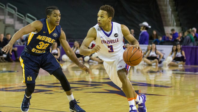 Evansville senior Jaylon Brown (3) dribbles around Murray State's Bryce Jones last season at the Ford Center. Murray State is one of four schools being considered as potential additions to the Missouri Valley Conference.