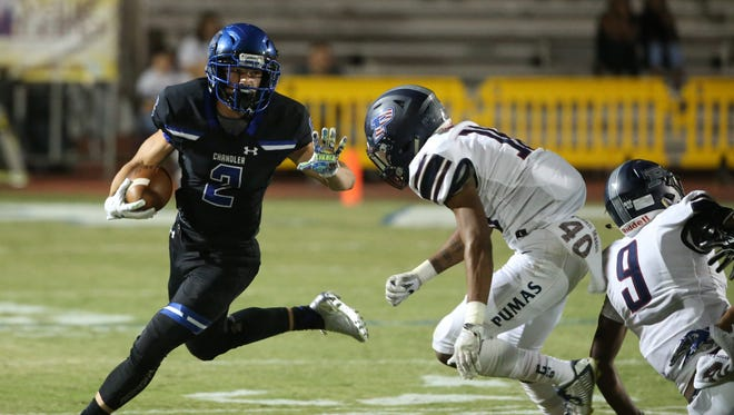Chandler's Drake Anderson (2) stiff-arms Perry's David Eppinger (16) in the first half at Chandler High School in Chandler, Ariz. on October 6, 2017.