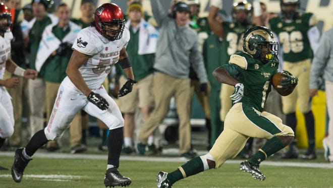 CSU's Dalyn Dawkins runs away from a UNLV defender during the Rams' 49-35 win last Saturday at Hughes Stadium. CSU visits New Mexico for a game this Saturday.