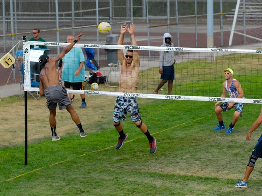 A player in the Men's Open division hits a ball over the net Sunday, July 31, during the annual Volleygrass at Port Huron Northern High School.