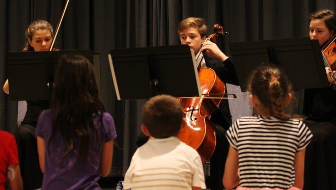 Kids listen to the Gunter Family Trio.