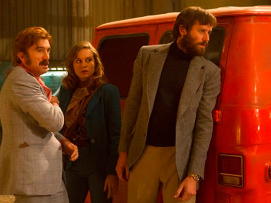 """This image released by A24 shows, from left, Sharlto Copley, Brie Larson and Armie Hammer in a scene from """"Free Fire."""""""