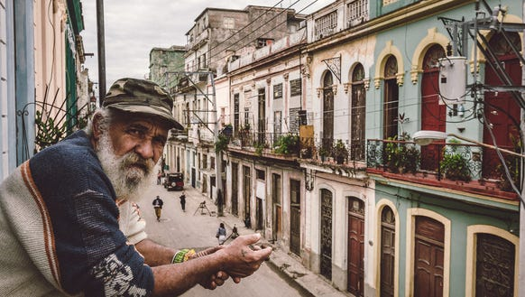 A man poses for Susan Portnoy from a window in Havana,