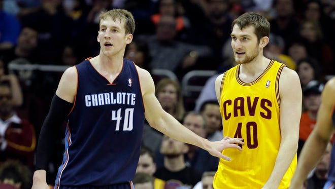 Charlotte Bobcats' Cody Zeller, left, checks his brother, Cleveland Cavaliers' Tyler Zeller, in the third quarter of an NBA basketball game Saturday, April 5, 2014, in Cleveland.