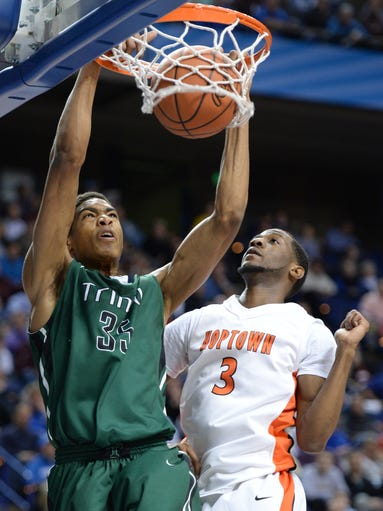 Trinity center Ray Spalding slam dunks the ball during the first half of the KHSAA Boys Sweet Sixteen Basketball Tournament game between Trinity and Hopkinsville at Rupp Arena in Lexington, KY. Thursday, March 20, 2014. Photo by Mike Weaver, Special to the C-J.