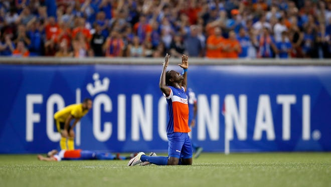 FC Cincinnati Djiby Fall (9) drops to his knees in celebration as time expires in the second half of the US Open Cup soccer match between FC Cincinnati and Columbus Crew at at Nippert Stadium on June 14, 2017.