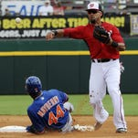 Ian Desmond of the Washington Nationals turns the double play on New York's John Mayberry, Jr., during Tuesday's game at Space Coast Stadium.