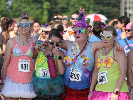 Paula Naidu, Kellan Selle, Jullie Roark and Nikki Brannon pose before the Roo Run at the Bonnaroo Music and Arts Festival 2018 on early Saturday morning, June 9, 2018