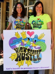 Susan Gallagher, left, and Leilani Slama were doing their best disco impression to promote the High Street Hustle race.