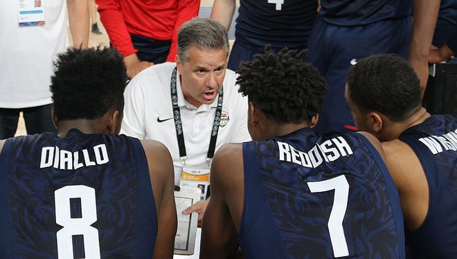 Coach John Calipari instructs Team USA during a timeout in the win against Italy at the FIBA World Cup in Cairo on Tuesday July 4, 2017.