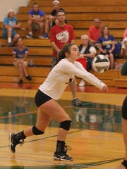Oak Harbor's Emma Bergman plays the ball in a match against the Clyde Fliers.