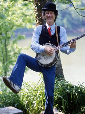Songwriter and entertainer John Hartford fiddles and dances a jig at his home on a bluff overlooking the Cumberland River April 29, 1985.