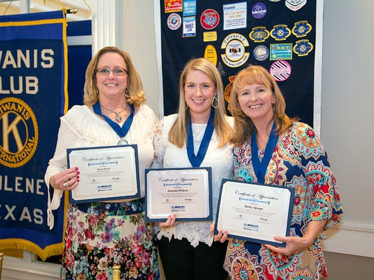Sherry Weeks, Amanda Wiskow, and Becky Spargo were presented with Zeller Fellow Awards at the Aug. 30 meeting of the Kiwanis Club of Abilene, given in recognition of a $1,250 donation to the Kiwanis International Eliminate Project.