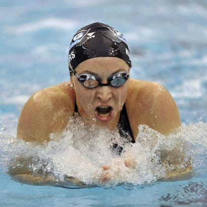Olympian sues USA Swimming to allege sexual abuse cover-up
