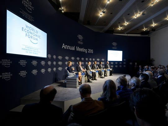 Participants attend a discussion at the World Economic